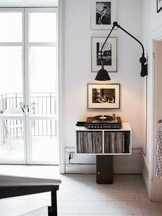 clean modern redord player and record storage in floating shelf / sfgirlbybay