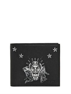 GIVENCHY TATTOO PRINTED LEATHER CLASSIC WALLET £315.00 on luisaviaroma (current 2014) Height: 9cm Width: 11cm Two internal bill compartments Eight card slots Tattoo printed front and back panels Logo embossed front and internal panels Made in Italy 100%LAMB