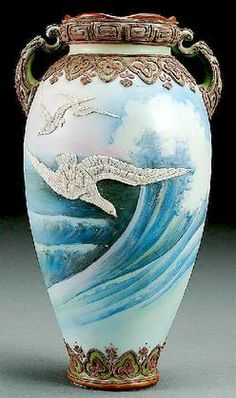 pottery & porcelain, Japan, A Nippon moriage seagulls decorated porcelain two-handled vase circa 1915, moriage seagulls against a painted scene of blue crashing waves under a scrolled moriage shoulder. Blue Maple Leaf mark.