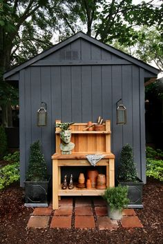 Amazing Shed Plans - Potting Bench against Black Shed // Love the lanterns as sconces - Now You Can Build ANY Shed In A Weekend Even If You've Zero Woodworking Experience! Start building amazing sheds the easier way with a collection of shed plans! Shed Landscaping, Backyard Sheds, Outdoor Sheds, Backyard Storage Sheds, Painted Garden Sheds, Painted Shed, Black Shed, Black House, Shed Makeover