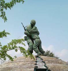 Statue of North Korean and South Korean brothers hugging during war. War Memorial Museum Seoul, South Korea