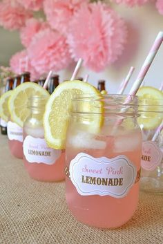 Sweet Pink Lemonade with Pink Striped Straws in Mason Jars.