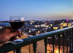 A glass of Portuguese wine with a view of Lisbon.