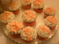 cupcakes with flowers and coconut icing