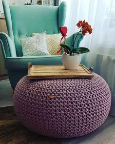 The crochet puff is a versatile, low-cost piece that contributes to the comfort and warmth of environments such as bedroom and living room - the most Navy Blue Sofa, Acrylic Blanket, Crochet Pouf, Colourful Living Room, Striped Rug, Beautiful Crochet, Knitting Yarn, Bean Bag Chair, Ottoman