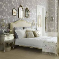 Beautifully decorated room with the bird cage accents, iron mannequin (I've seen one of these at Home Sense), the lavender and cream colour palette, and the whimsical wallpaper.