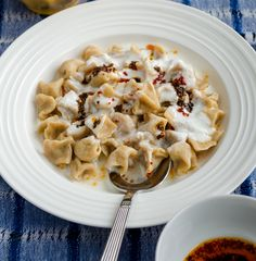 Turkish dumplings filled with spicy ground beef. Boil them just like pasta and serve with yogurt and hot butter with mint and chili.To die for! | giverecipe.com | #dumplings #turkish