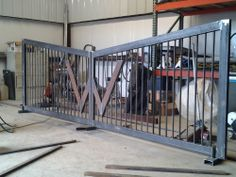 """*Prices will vary … Based on a 15' gate with an initial, hinges and painted black. -Custom Colors add $200Materials Used:-2x4 metal tubing 1/8"""" -3/4"""" - 14ga square tubing for the pickets-Primer-Paint-Heim joint hinges-Welded for strength.*Install available, please inquire about prices."""