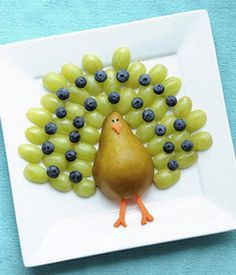 Fruit Turkey Snack--- except make a peacock instead of turkey by adding purple grapes and maybe do a dark pear body...