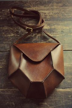 Entirely handmade using premium full grain veg tanned leather Hex crossbody shoulder bag. Hand cut, dyed, sewn with waxed linen thread and