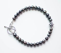 Items similar to Freshwater pearl bracelet with silver toggle clasp, dark grey pearl bracelet, boho pearl bracelet, pearl layer bracelet on Etsy Freshwater Pearl Bracelet, Moon Jewelry, June Birth Stone, Handmade Jewelry, Unique Jewelry, Beaded Flowers, Gifts For Her, My Etsy Shop, Beaded Necklace