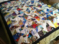 This was a star pattern in four colors. It was very pretty. Staying within light, medium light, medium-dark and dark, I created this scrappy star quilt.