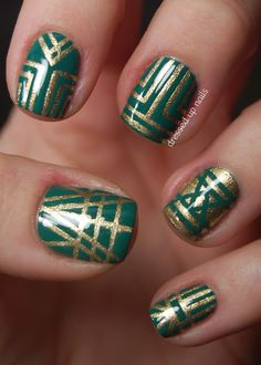 Emerald and gold striping tape art deco style nail art. Pretty but ain't nobody got time for that.