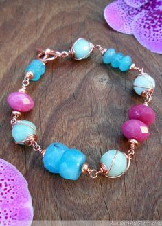 "Create an eye-catching wirework bracelet featuring gemstones caged in swirls of copper. Mix in pops of color with a variety of natural gemstones in a cheerful springtime palette. Size: 8.5"" long Ma..."
