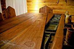 The wood paneling is air-dried cypress that has gone through a six step staining process in order to give it the aged look you'd expect in an old tavern.