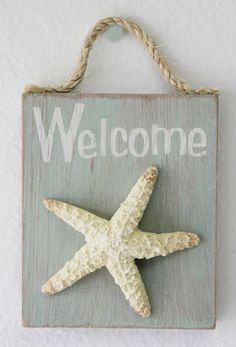 A beach-chic style Welcome sign adorned with a starfish and rope for hanging.