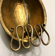 """Cast wire necklace separator to hang off then steel pin on your Viking Turtle brooches. You can hang multiple strands of beads and Viking necklaces off the loops of the wire. 1 1/2"""" x 7/8"""", 3.8 cm x 2.3 cm Set of 2 wire hangers"""