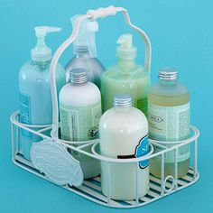 I soooo want one of these wire/metal caddies for the laundry area.  This one is a cute idea for a linen closet, you fill it with bath essentials, that's a great idea too!  Especially for a small bath!