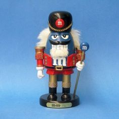 "8.3"" M&M Nutcracker Color: Blue by Kurt Adler. $12.40. 8.3"" M&M blue nutcracker. Kurt Adler item # MM6121M. MM6121M Color: Blue Features: -Standing in a traditional red and gold nutcracker soldier uniform.-M&M grins with a fluffy white goatee and holds a glittering M&M staff."