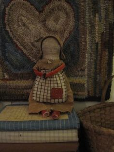 """Fat Hen Farm - Primitive Rag Doll - Early Calico... Her rolled arms are red velvet (my last!) and leg are early turkey red. Her body is made from early cotton fabric. Her dress is early brown calico patched with a wonderful old brown fabric! She has a repaired head. She is stuffed with bits of old cloth and cotton. She is made completely by hand with tiny stitches and early fabrics. She is approx. 10"""" tall. She is completely adorable! :-) A Fat Hen Farm original, signed and dated."""