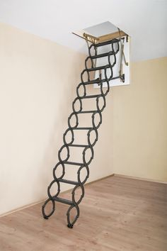 from FAKRO - Scissors Attic Ladder.  No sharp corners or cumbersome unit to fold and snap back at you! Like Like!