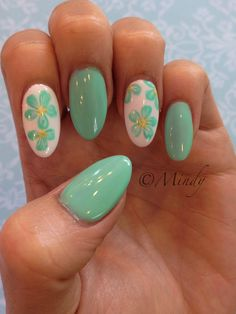 Tiffany blue floral nails art on almond shaped nails