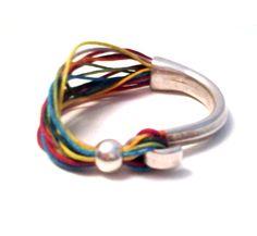 Pulsera en plata y cordón multicolor