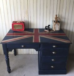 Union Jack-inspired computer desk, painted in ASCP Napoleonic Blue, Emperor's Silk, Old White, distressed, and sealed with lashings of dark wax. It's dark and moody and patriotic and FOR SALE £350 H:25.5cm W:122cm D:61.5cm