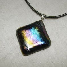 Black iridized fused glass necklace | dancinghorsestudio - Jewelry on ArtFire  $16 plus shipping  15% off is you spend $20 or more in my Artfire shop - use code XMAS15.