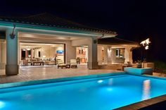 Love how the house completely opens to the pool.