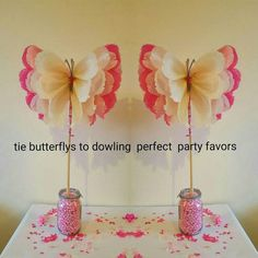 Handmade made to order beautiful butterflies/ pom poms These delightful Pom poms are the perfect decoration to brighten up any room/space to be admired by everyone. They are perfect for childrens birthdays or any special occasions. These pom poms are all handmade as shown in the pictures