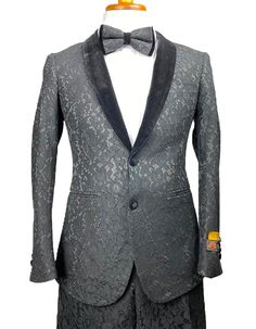 This black floral lace tuxedo is the perfect tux for prom, or any event where you want to make a statement. It features a black lace floral overlay fabric, with a velvet shawl lapel. Comes with matching slim flat front pants, and a matching oversized bowtie. #PromTuxedo #Tuxedo #BlackTuxedo #WeddingTuxedo #PromTux #WeddingTux #Tux #Wedding #Prom