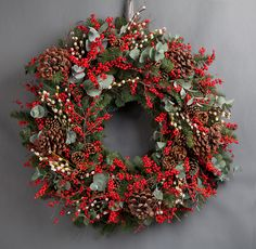 Wild at Heart Classic Red Berry Wreath. This traditional red berry wreath uses ilex berries, pine cones, pussy willow and eucalyptus.
