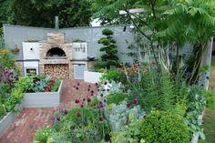 diseño de jardín moderno con cocina exterior