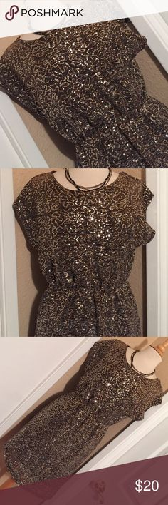 Sequin Mini Stunning Sequin Mini. Gold detail & brown underlay. NWT attached. The back of the dress has a fun cut out detail. This would be perfect for any event where you need to look your very best! Charlotte Russe Dresses