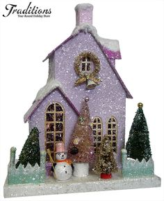 Charming, silver-flecked, vintage Winter Wonderland:  lavender cardboard / Putz church with little gold wreath and sugar bell, mint green fence, bottle brush trees, snowman. Love!  <> (yesteryear, retro, Christmas decor)