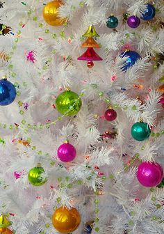 Colorful Christmas balls really pop against a white Christmas tree.  Could your tree be white or is green the only color tree for you? I'd almost consider a white tree because this is pretty!