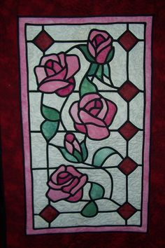 Stained Glass Rose Quilt- looks like beauty and the beast