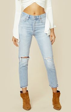 """Your new favorite pair. These high rise jeans by Citizens of Humanity features distressing throughout, a straight lean leg, and 5 pocket styling.   Made in USAMachine Wash ColdCotton BlendFit Guide:Model is 5ft 9 inches; Bust: 32"""", Waist: 24"""", Hips: 35""""Model is wearing a size 24High Rise FitShoes Featured Not Available For Purchase"""