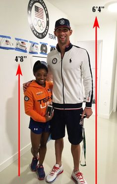 "6ft 4"" Michael Phelps towers over 4ft 8"" Simone Biles ...but they're both CHAMPIONS! #TeamUSA #Rio2016"