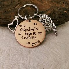 Check out this item in my Etsy shop https://www.etsy.com/listing/150581012/personalized-keychain-grandma-keychain