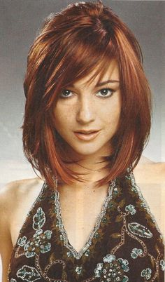 Swept up with the layered look?  Add in sexy bangs and it's easy to understand why.  As you can see an alluring color with layers, bangs and bobs make for a hard combination to beat.  For other unbeatable ideas why not click over to terrifictresses.com.