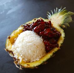 Divide the chicken between the two pineapple boats, and serve with a scoop of rice!