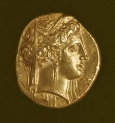 GREEK COIN Taras, ca. 342 - 33 B.C.,  Gold Diam. 20 mm (approx.) Minted by the city of Taras (now Taranto), the obverse shows the head of the goddess Persephone (or Hera), wearing a decorated stephane and a transparent veil at the back, as well as an earring and necklace. The composition, of exceptional artistic quality, refers to the appeal made by Taras to Sparta – the homeland of Taras' founding colonists – to provide military support against the Italiote peoples. This explains the…