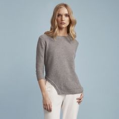 FINDERS | Grey Knit Long Sleeve Side Slit Sweater The Cheap Talk Sleeved Knit is a fitted pullover jumper with a rounded neckline, cropped long sleeves, an asymmetric curved hem shape on the right side and ribbing details on the hem, cuffs and neckband in a mid-weight knit fabric. Designed in Australia. Colour: Grey Fabric: 55% Acrylic / 45% Cotton Care: Wash and dry inside out on cold.Do not dry-clean.  This item is available in multiple sizes, please contact for sizing availability…