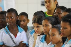Students watch a performance by their peers at Barros Barreto School, in Salvador, Brazil. The performance tackled social issues such as racism and gender discrimination.. Photo: UNICEF/Claudio Versiani