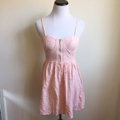 Blush Pink Eyelet Dress with Corset Style Top Pretty soft pink dress with flattering bust detail.  Exposed zipper in from and invisible side zipper.  Adjustable spaghetti straps.  Measurements available upon request.     👍🏻👍🏻 Bundle and SAVE! 👍🏻👍🏻 🛍 10% off 2 or more items 🛍 🙅🏻🙅🏻 NO TRADES 🙅🏻🙅🏻 🚫🚫NO MODELING🚫🚫 Forever 21 Dresses