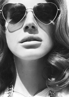Lana Del Rey baby put on heart shaped sunglasses cause we gon take a ride