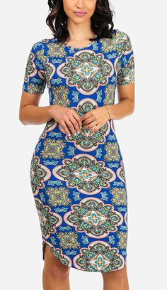 This medallion-patterned dress features a curved hem and curve-hugging fit