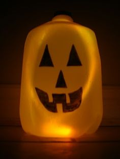 Water Jug Pumpkins - A super EASY craft for Halloween....uses a glow stick to light up.